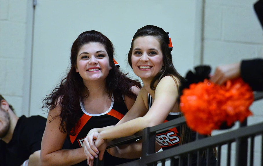 Two smiling cheer team members
